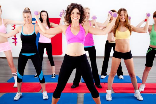 image of women doing aerobics with dumbbell