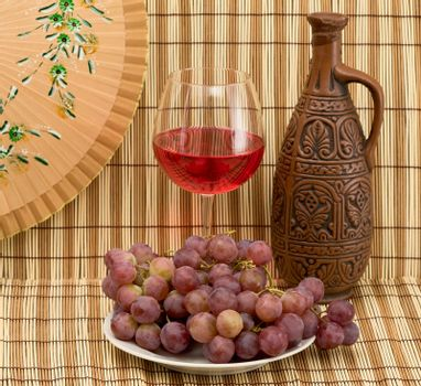 Bottle, bucket, goblet and grapes