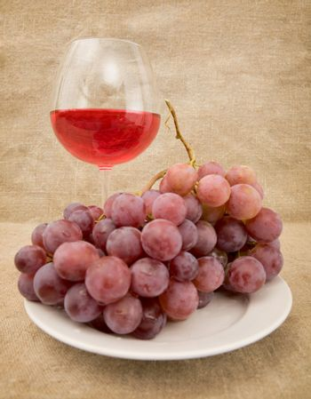 Goblet and grapes