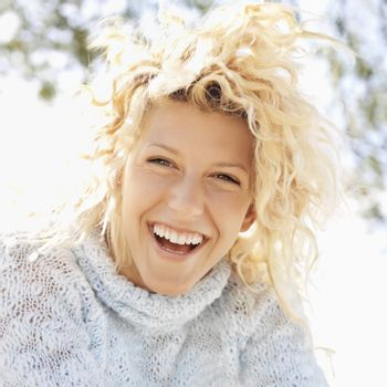 Attractive young blond woman smiling and laughing in Maui, Hawaii.