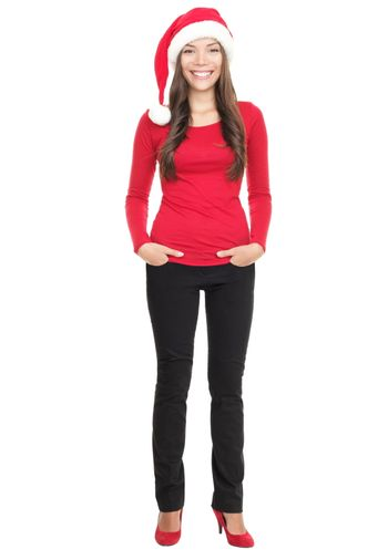 Young woman smiling with Santa hat