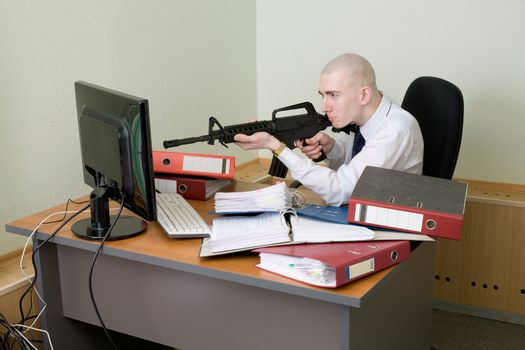 Clerk shoots from a rifle at the monitor