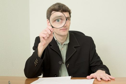 Clerk at office with magnifier