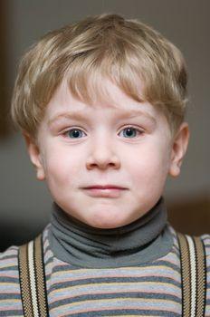 Cute little boy looking forward