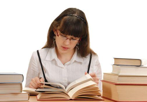Schoolgirl reading books. Shot in studio over white.