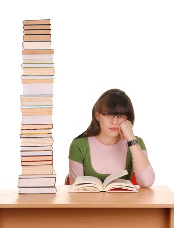 Teenage girl with many books to read