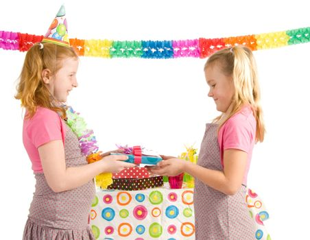Blond girl giving a present to another girl for her birthday