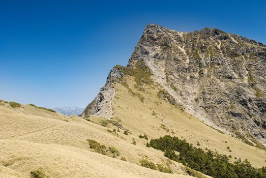 Dangeours and majestic rock peak of high mountain.