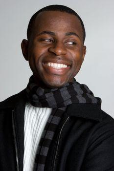 Smiling black man wearing scarf