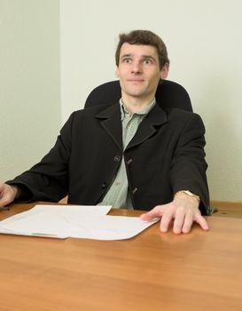 Clerk at office sits at a desktop