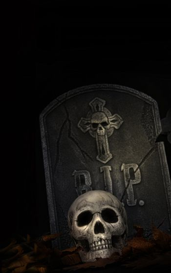Spooky tombstone with skull on black