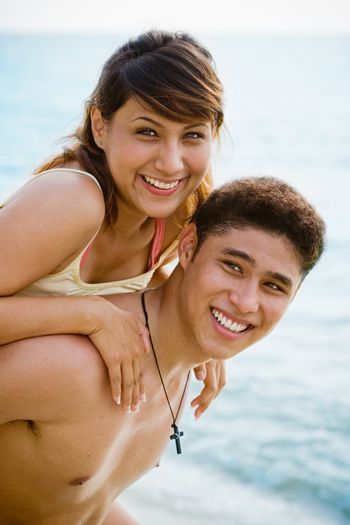 happy couple by the beach