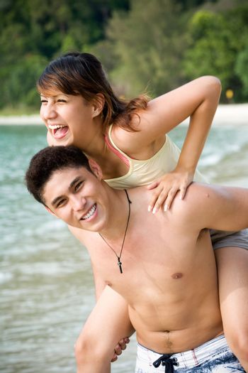 couple having fun with each other by the beach