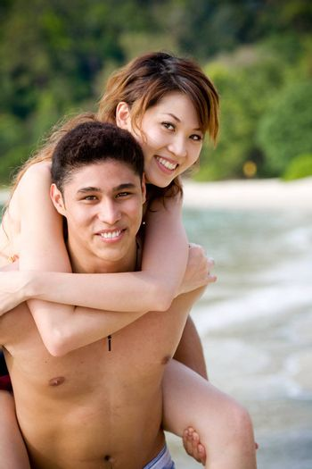 couple enjoying romantic time by the tropical beach