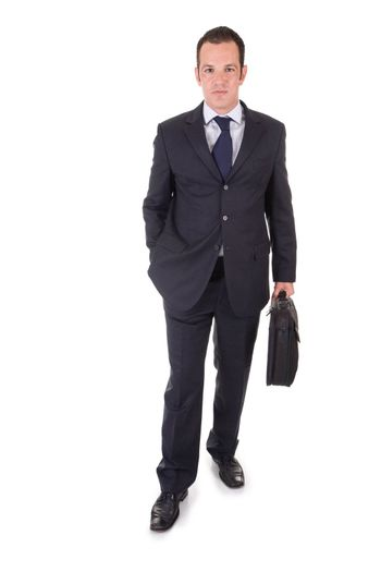 Handsome Young Businessman, standing with a suitcase. Isolated on white.