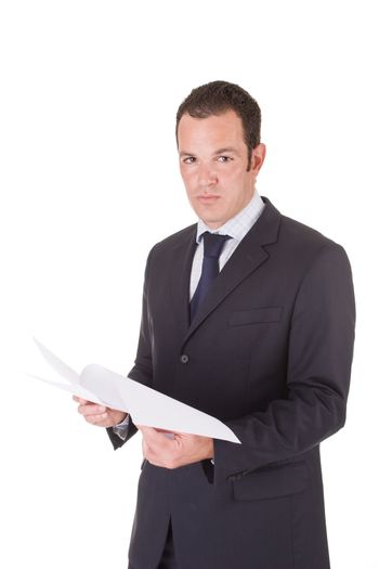 Young handsome business man handling documents. Isolated on white background.