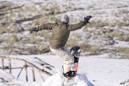Men jumping on a snowboard