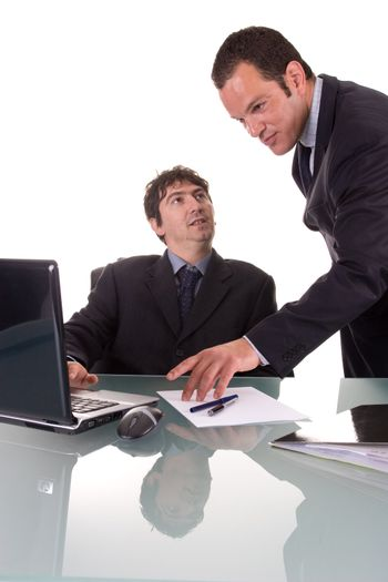 Two young businessmen, discussing a project. Isolated on white background.