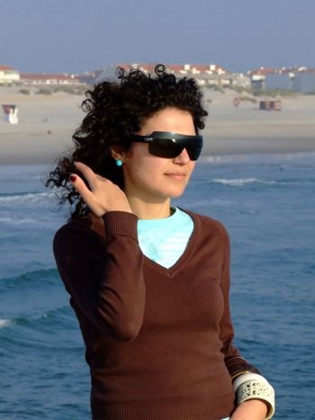 Woman with sun glasses on the beach