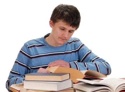 Teenager sitting behind a desk and reading books