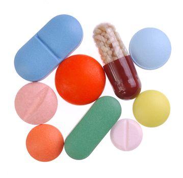 Macro of pills isolated on white background