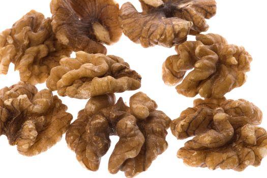 Isolated macro image of walnuts.