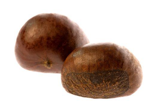 Isolated macro image of roasted chestnuts.