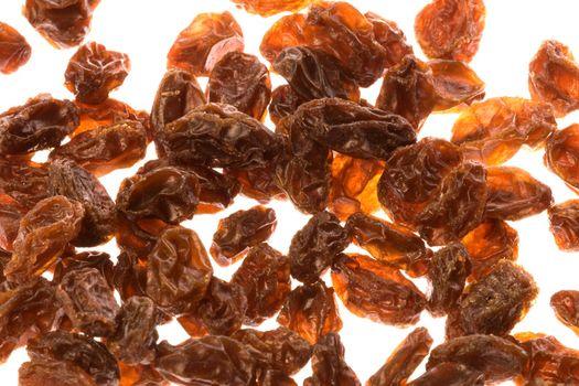 Isolated macro image of dried raisins.