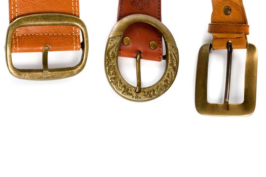 three brown leather belts
