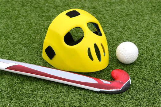 Field hockey equipment on green grass