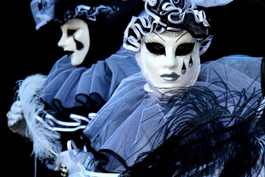 Pierrot on black background at Venice Carnival
