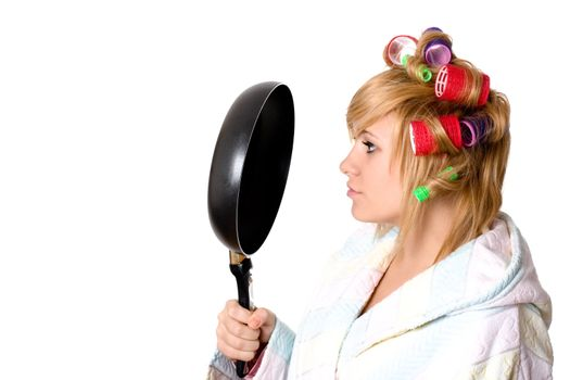 housewife with curlers and pan