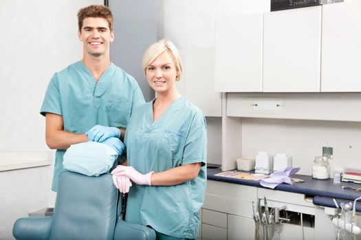 Portrait of a confident male and female dentists smiling at dental clinic