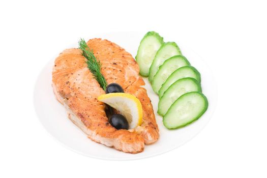 Appetizing Grilled Salmon with sliced cucumber, lemon and black olives isolated over white