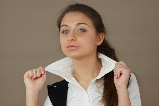 Student girl over light brown background