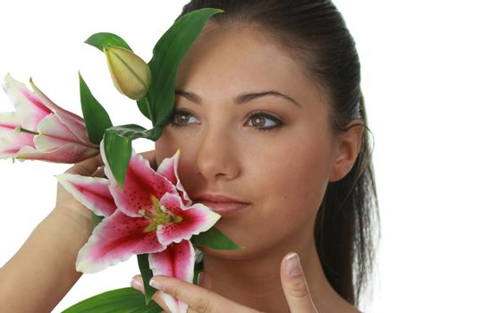 Portrait of young attractive woman with beautiful lilly flower
