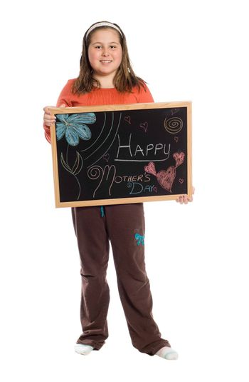 A young girl holding up a chalkboard for mothers day, isolated against a white background
