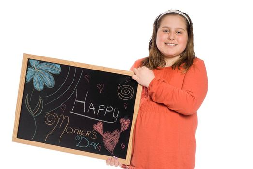 A young girl holding up a chalk drawing for mothers day, isolated against a white background