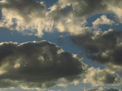 A photograph of clouds in the sky.