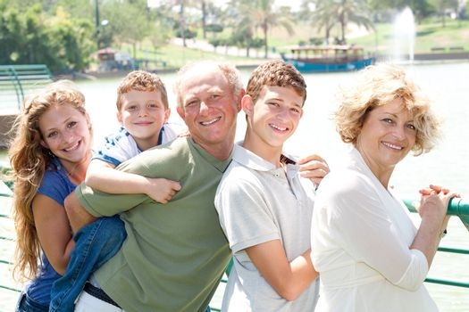Closeup portrait of a happy family standing together in outdoor
