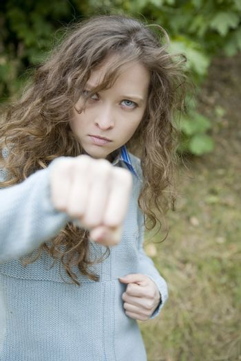 attractive young aggressive  female punching