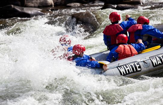 Group in out of control white water raft
