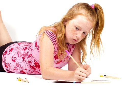 redhead girl is doing her homework