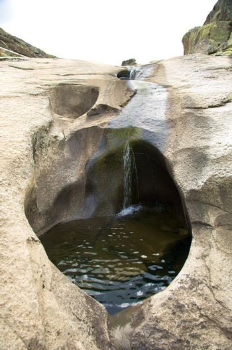 water falling on rock