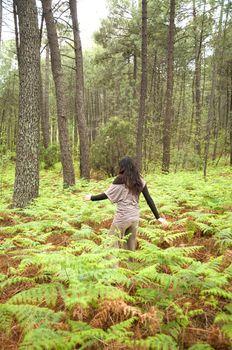 woman through fern field