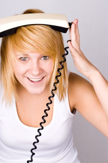 blond woman with retro telephone