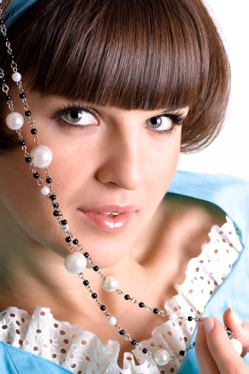 brunet woman with pearl beads
