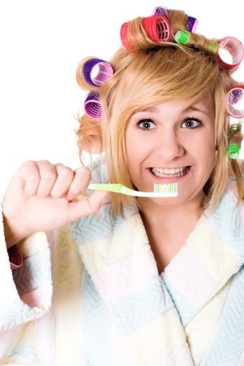 funny housewife with curlers and toothbrush
