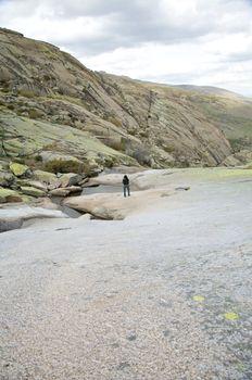 woman on rock mountain