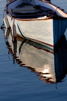 Morning light on a grey boat